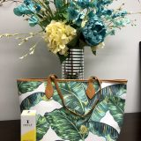 tropical print bagunder flowers with skin care products