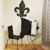 black fleur de lis over a table and chair